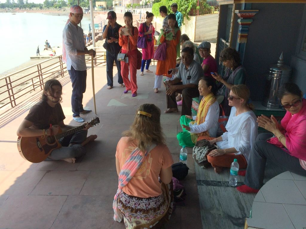 Chanting at a riverside temple