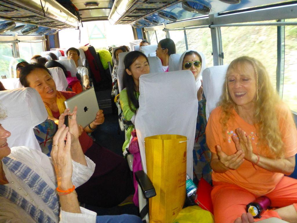 Yogini Kaliji leading chants on the bus