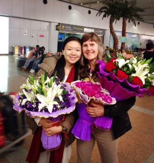 TriYoga_Tina_greets_Gina_airport_Beijing